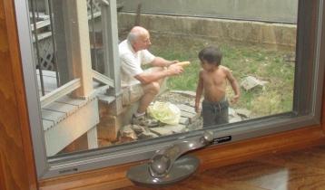 Shucking corn with Grandpa.